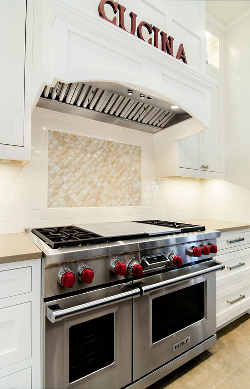 Traditional Kitchen with Custom hood, Crown molding, Flat panel cabinets, Travertine counters, Subway Tile, One-wall, Flush