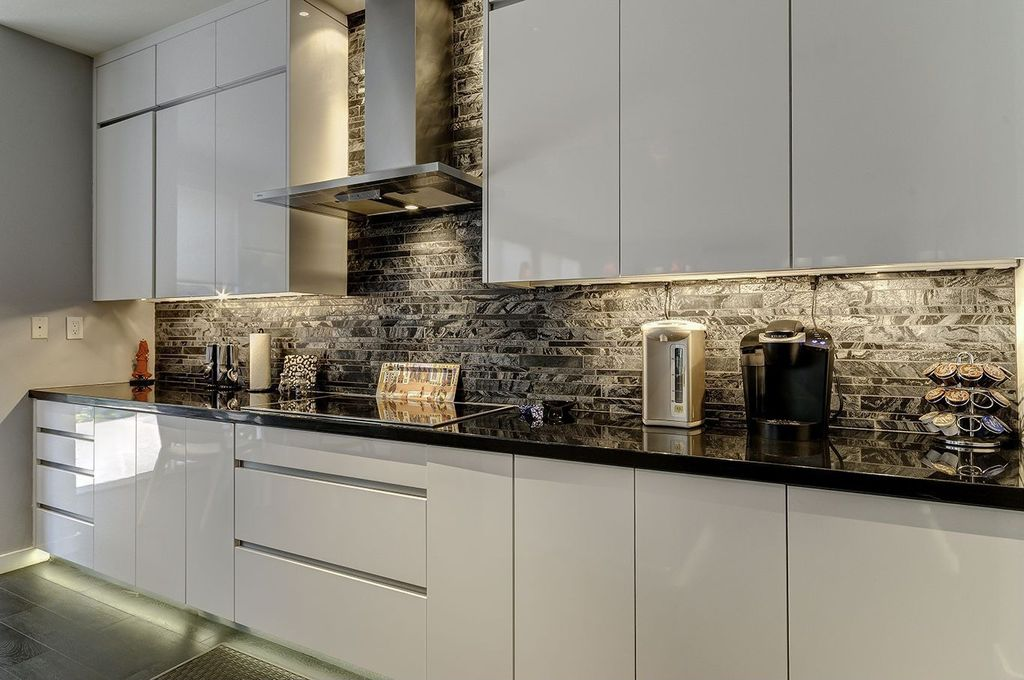 Contemporary Kitchen with can lights, electric cooktop, Wall Hood, One-wall, European Cabinets, Ceramic Tile, full backsplash