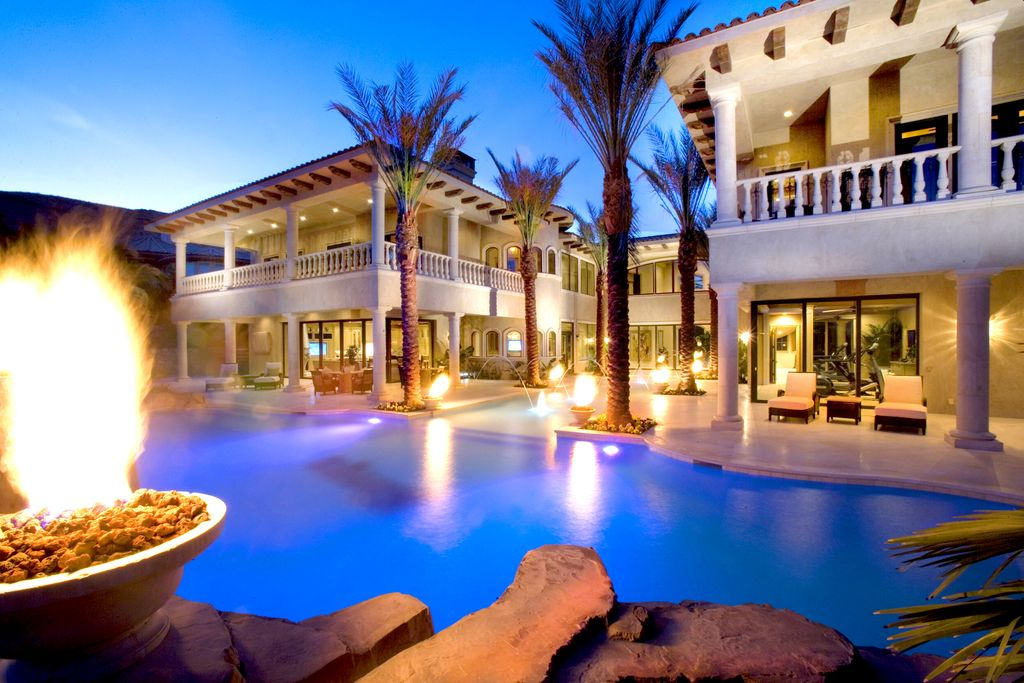 Mediterranean Swimming Pool with picture window, Fence, Arched window, exterior stone floors, sliding glass door, Fire pit