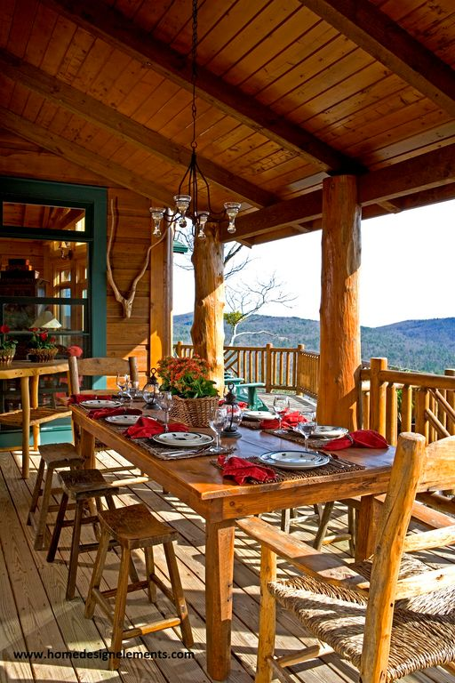 Rustic Porch with Wrap around porch, double-hung window, Deck Railing