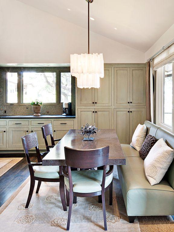 Contemporary Dining Room with Built-in bookshelf, Chandelier, Standard height, Casement, can lights, Hardwood floors