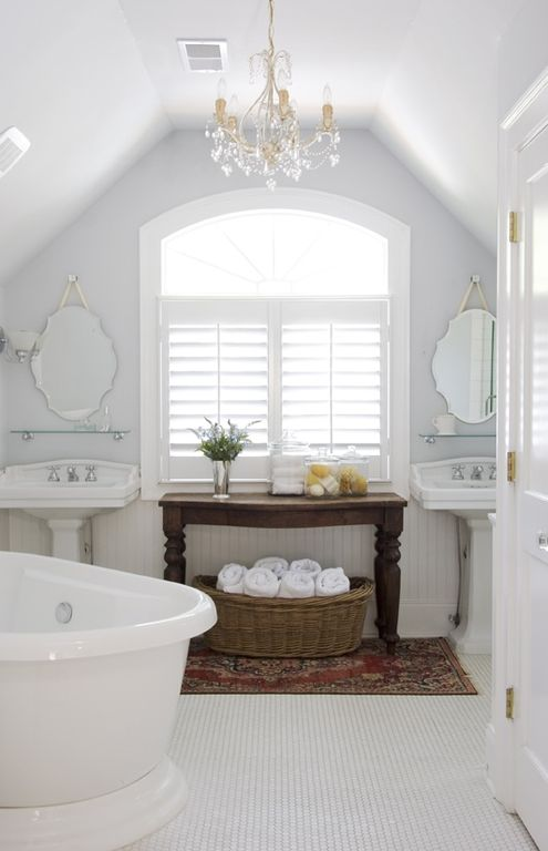 Cottage Master Bathroom with Arched window, Chandelier, penny tile floors, specialty door, Bathtub, High ceiling, Paint 1