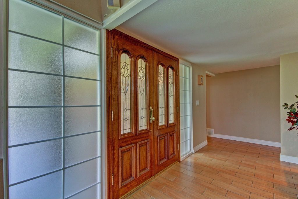 Craftsman Entryway with Standard height, Exposed beam, French doors, Stained glass window, Hardwood floors