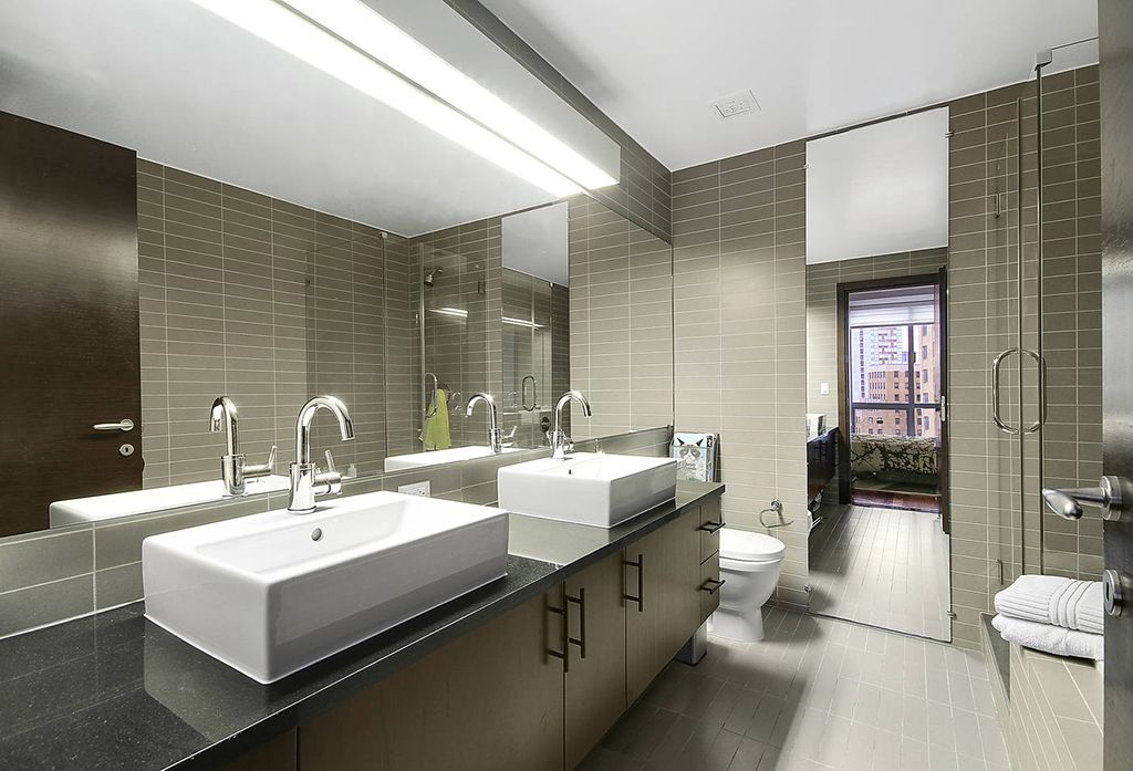 Contemporary Master Bathroom with stone tile floors, Double sink, Standard height, Flush, Wall Tiles, Shower, Stone Tile