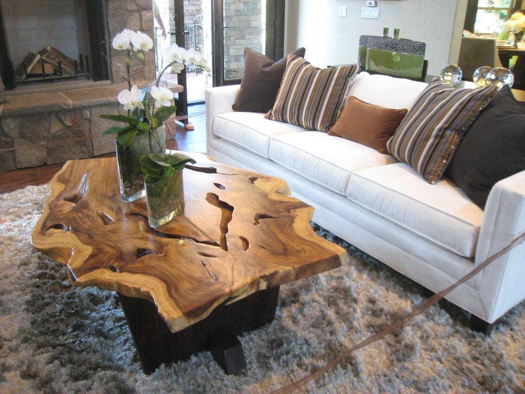 Rustic Living Room with Rustic slab wood coffee table with live edge, Upholstered sofa, Fireplace, Paint, Area rug