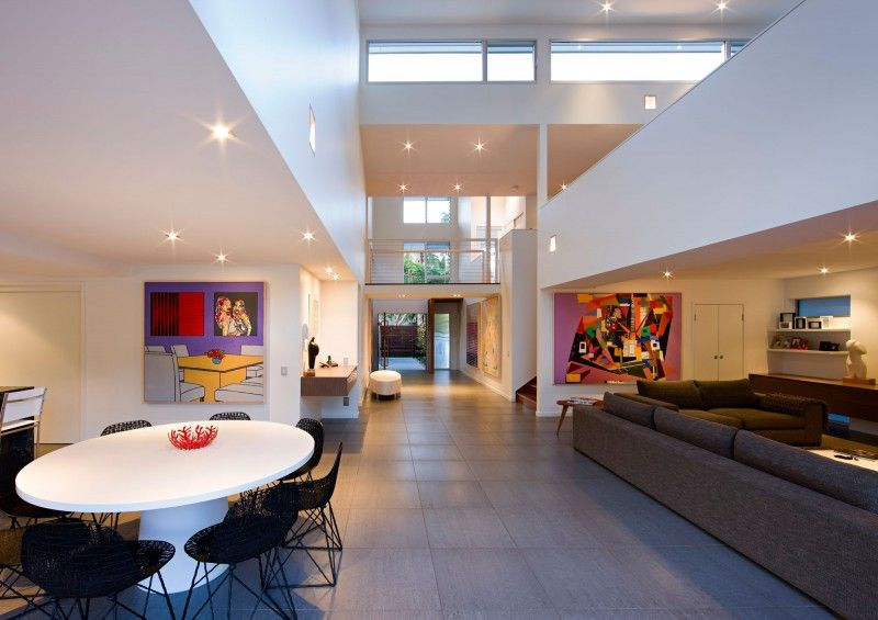 Contemporary Living Room with flat door, Built-in bookshelf, High ceiling, picture window, Concrete tile , can lights