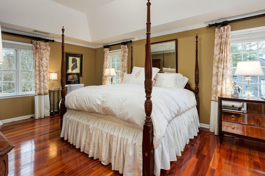 Traditional Master Bedroom with High ceiling, Hardwood floors, Crown molding