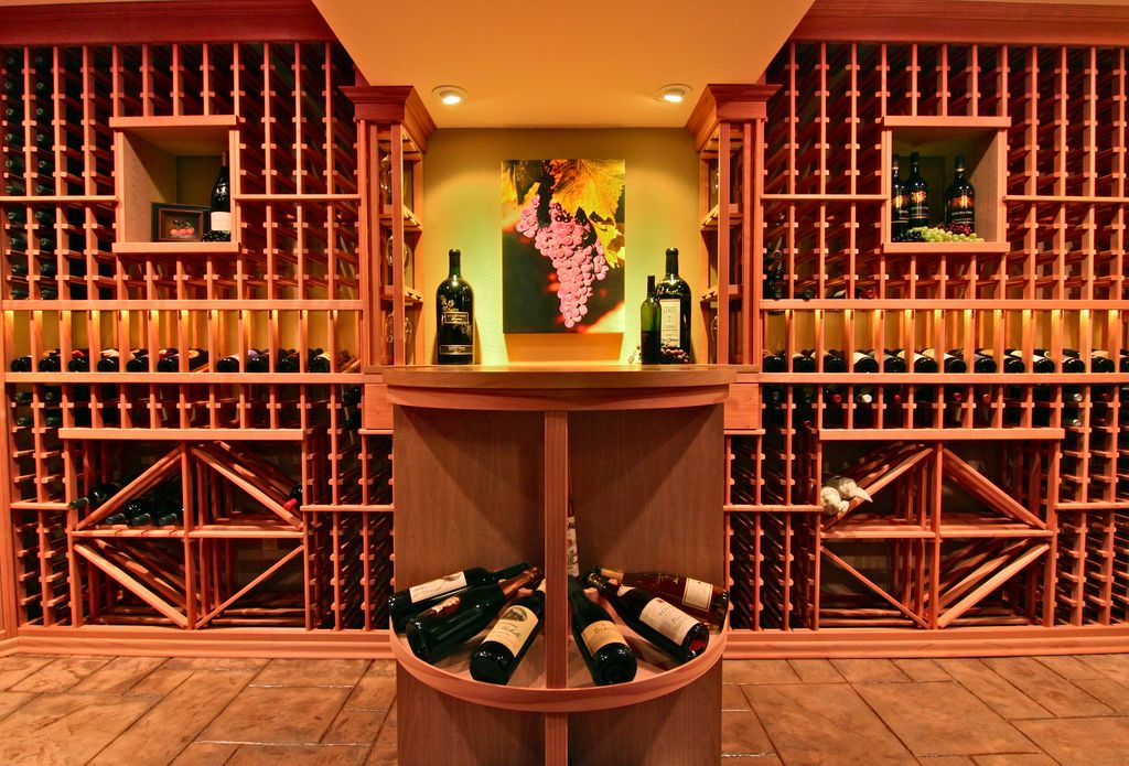 Traditional Wine Cellar with Standard height, can lights, Built-in bookshelf, Concrete tile