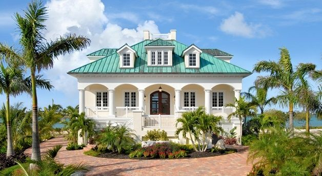 Tropical Exterior of Home with Palm trees, Exterior archway covered patio, Green copper roofing, Paint 1