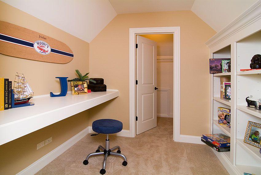Traditional Kids Bedroom with Concrete floors, flat door, Built-in bookshelf, Standard height