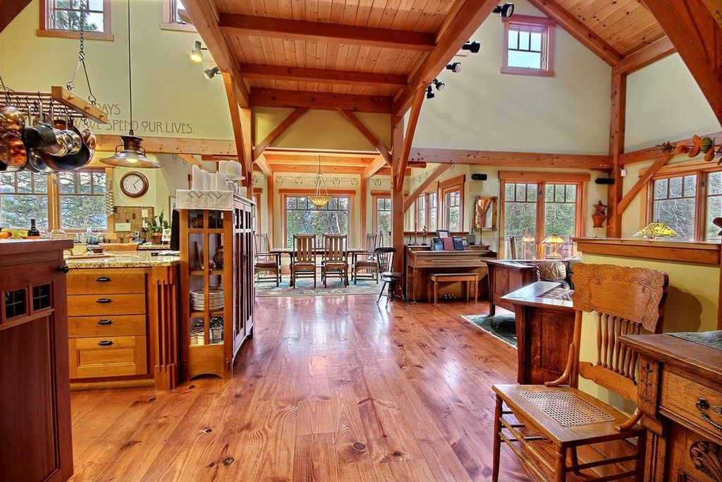 Craftsman Great Room with Wood panel ceiling, High ceiling, Hardwood floors, flush light, Loft, Pendant light, Area rug