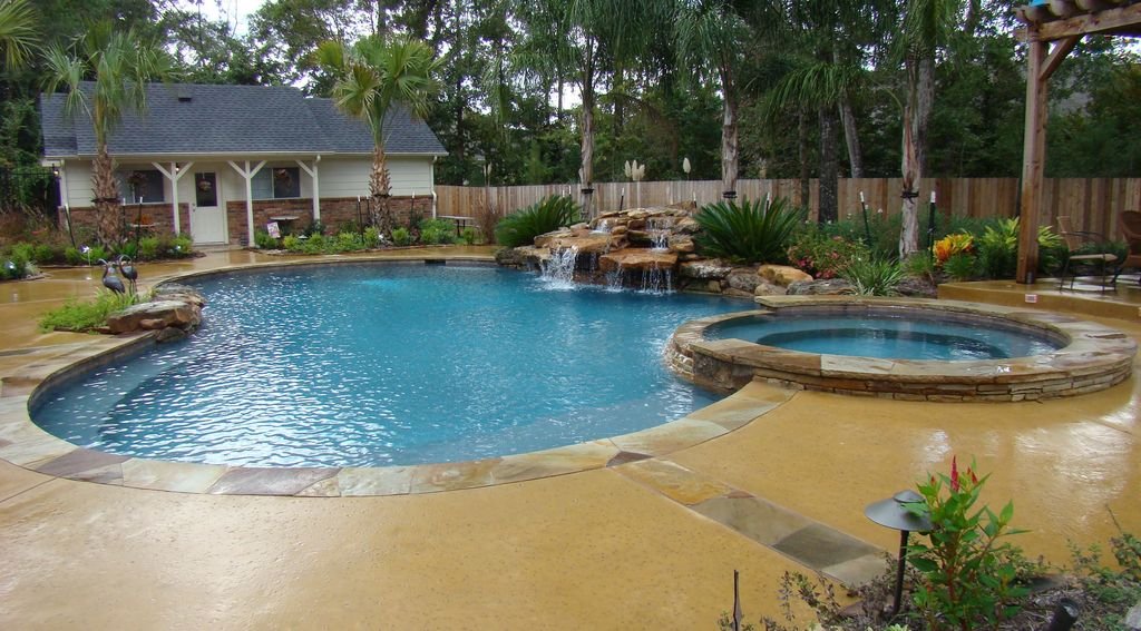 Tropical Swimming Pool with Pool with hot tub, Pool bench, Pool with waterfall, Wood pergola, Spillover jacuzzi