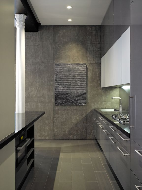 Contemporary Kitchen with wall oven, slate tile floors, European Cabinets, Standard height, full backsplash, electric cooktop