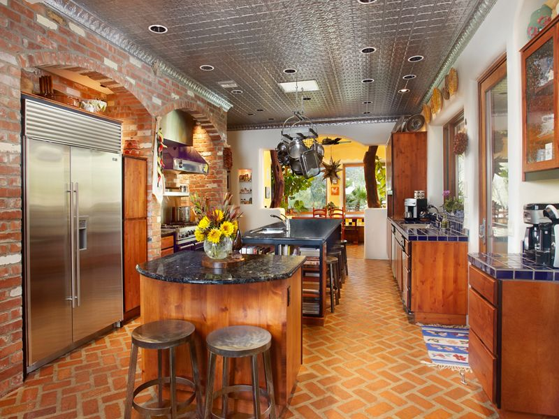 Eclectic Kitchen with Breakfast bar, Built In Refrigerator, Crown molding, terracotta tile floors, Standard height, Flush