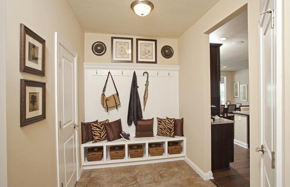 Traditional Mud Room with specialty door, flush light, travertine floors, Standard height, Built-in bookshelf