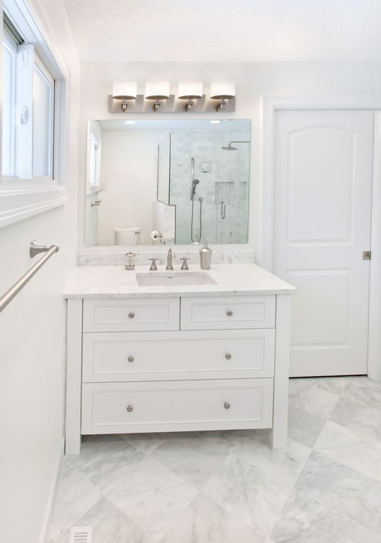Traditional 3/4 Bathroom with Pental aspen honed marble