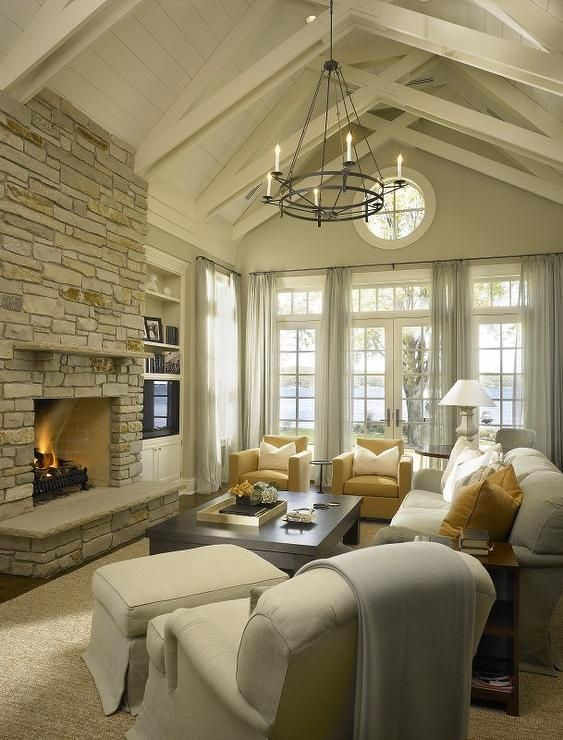 Contemporary Living Room with Exposed beam, Iron double ring chandelier, French doors, specialty window, Fireplace, Paint