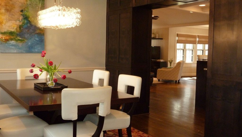 Modern Dining Room with Hardwood floors, High ceiling, Chandelier, Chair rail