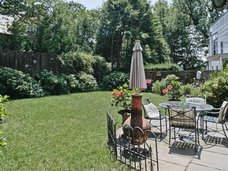 Traditional Patio with double-hung window, Fence, exterior stone floors, outdoor pizza oven