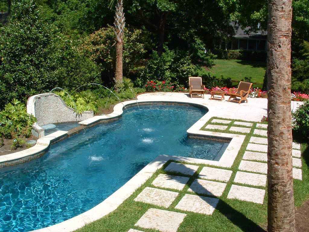 Traditional Swimming Pool with exterior stone floors, Fence, Other Pool Type, Fountain, Pathway