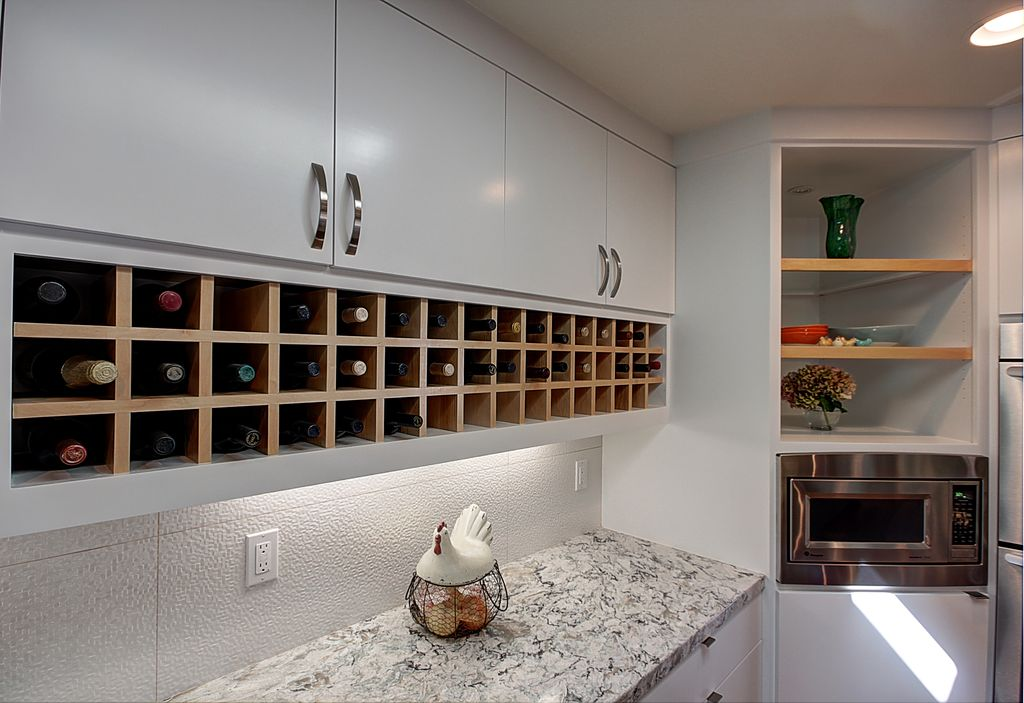 Contemporary Kitchen with European Cabinets, Standard height, L-shaped, built-in microwave, Flush, Built In Refrigerator