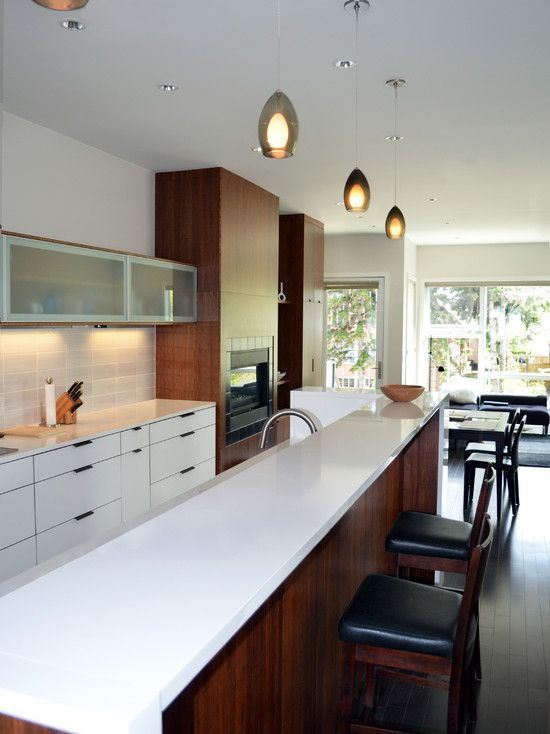 Contemporary Kitchen with Flush, full backsplash, built-in microwave, Limestone Tile, European Cabinets, Breakfast bar