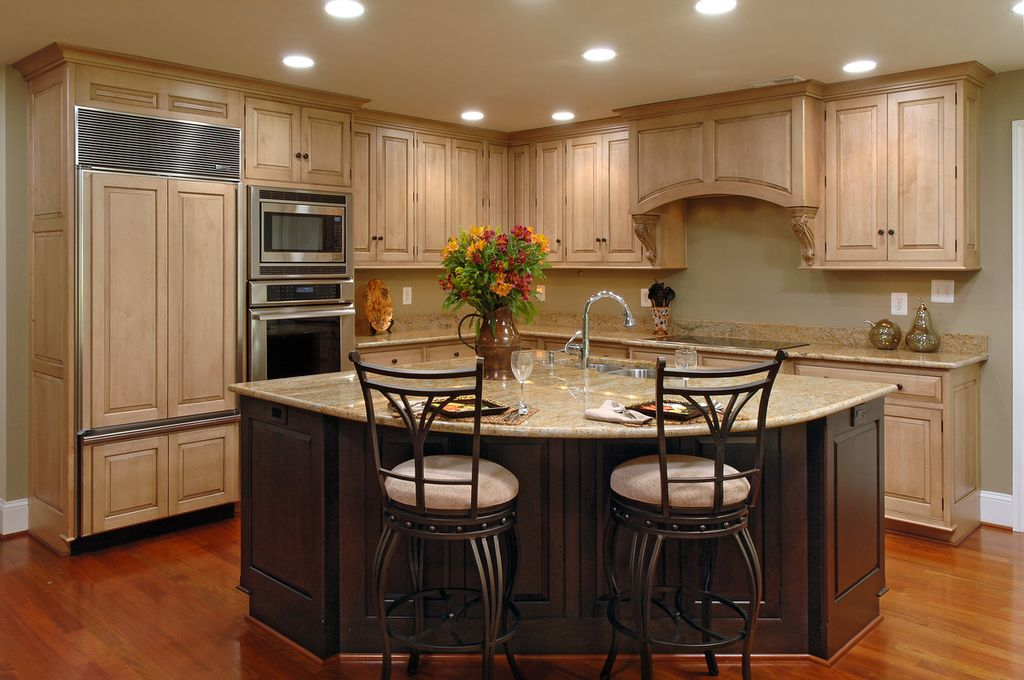 Traditional Kitchen with Inset cabinets, Custom hood, can lights, electric cooktop, Built In Panel Ready Refrigerator