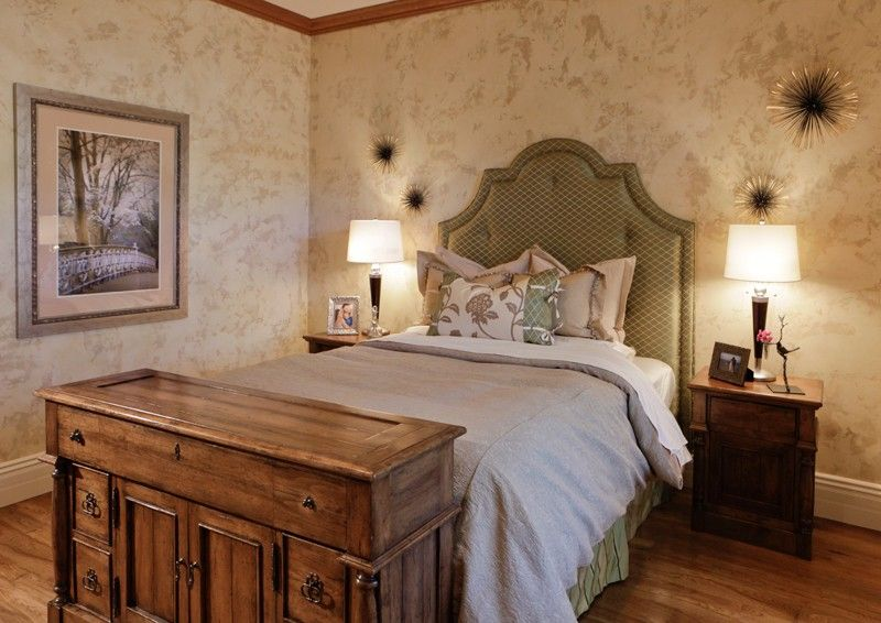 Traditional Guest Bedroom with Crown molding, Standard height, Hardwood floors, interior wallpaper