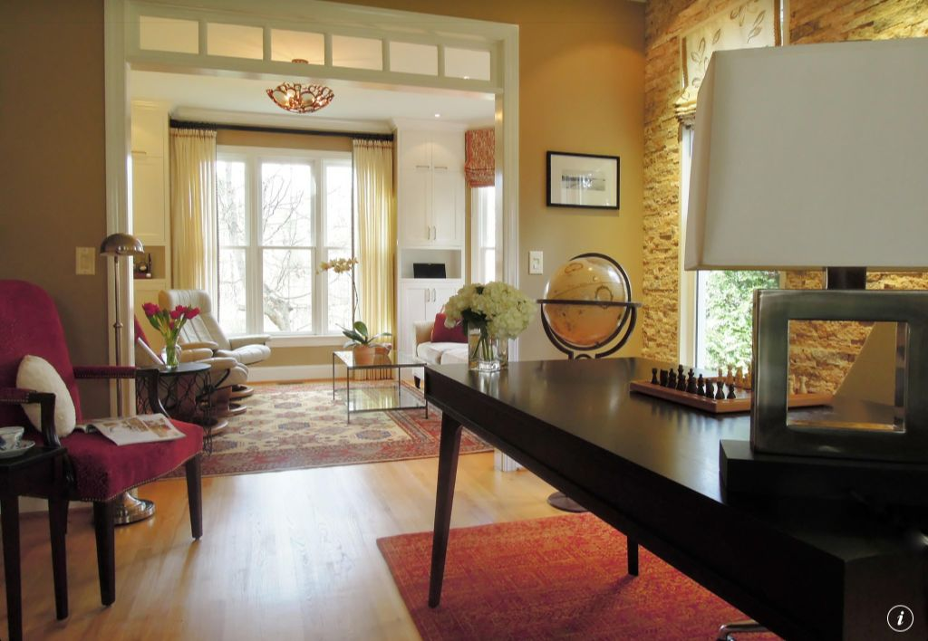 Contemporary Home Office with Laminate floors, Transom window, Standard height, picture window