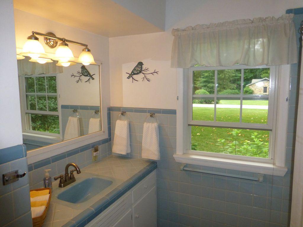 Traditional Full Bathroom with Large Ceramic Tile, full backsplash, High ceiling, Casement, large ceramic tile counters