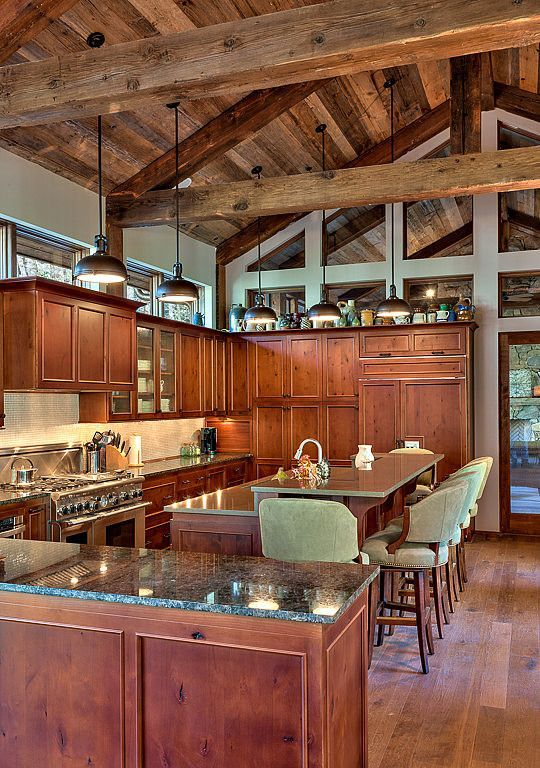 Country Kitchen with Simple granite counters, Limestone Tile, Custom hood, Exposed beam, Kitchen island, U-shaped, Flush