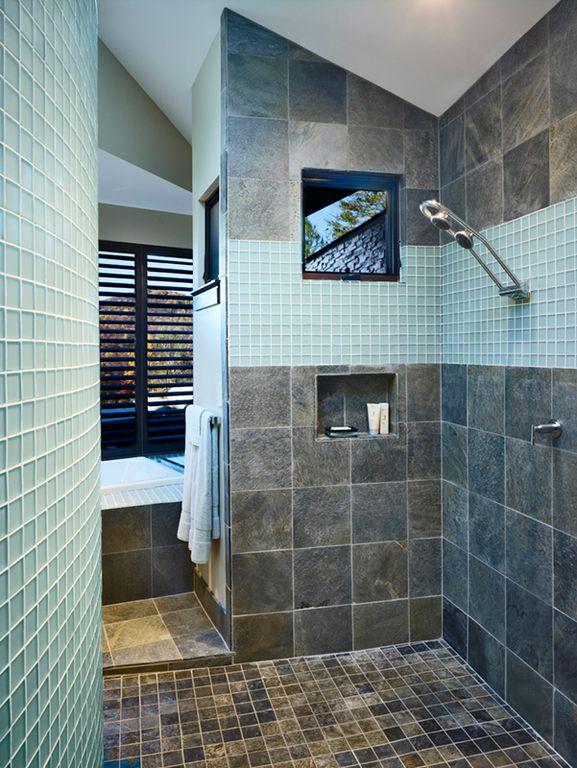 Modern Master Bathroom with stone tile floors, Shower, High ceiling, drop in bathtub, Bathtub, Casement, Master bathroom