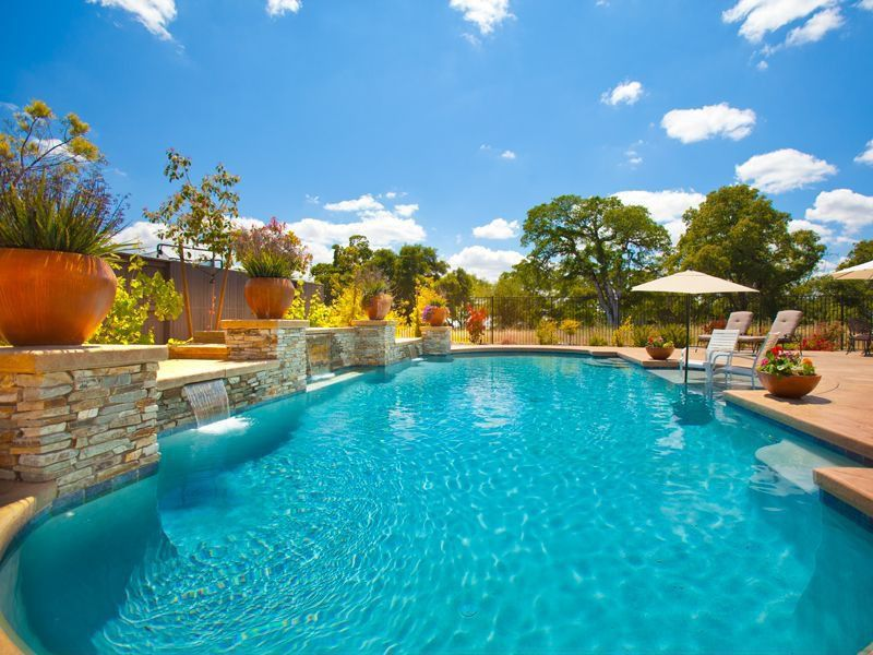 Mediterranean Swimming Pool with Fence, exterior stone floors, Other Pool Type