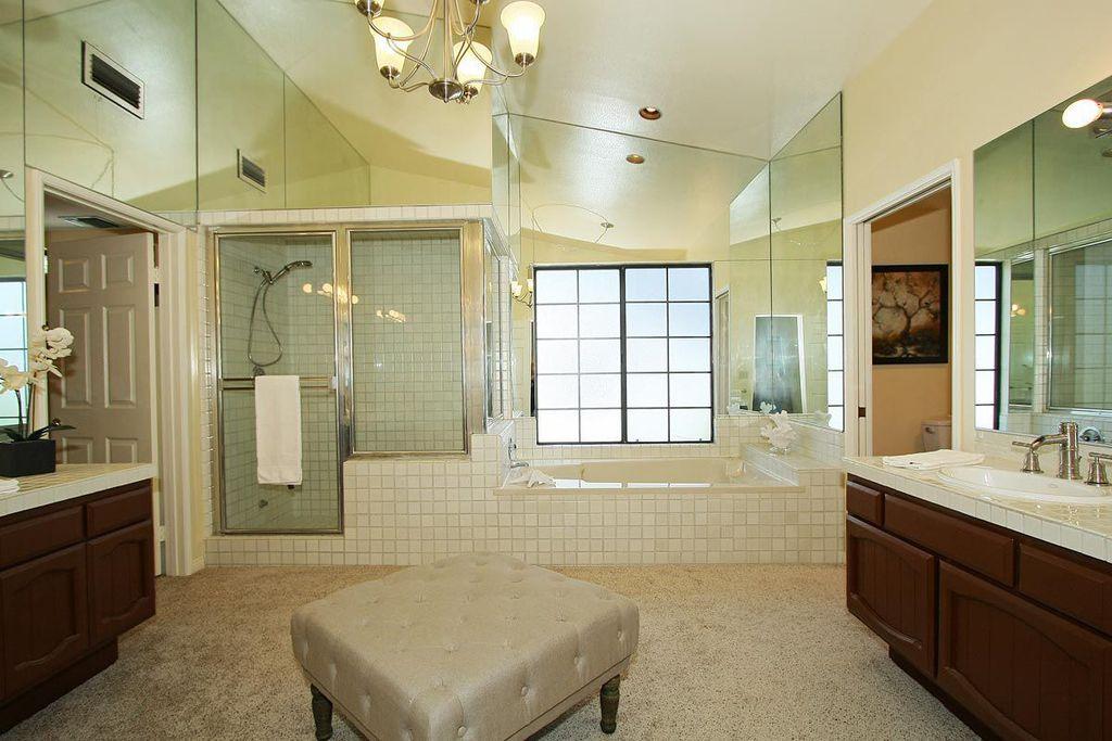 Traditional Master Bathroom with Shower, Chandelier, Bathtub, framed showerdoor, Drop-in sink, large ceramic tile counters