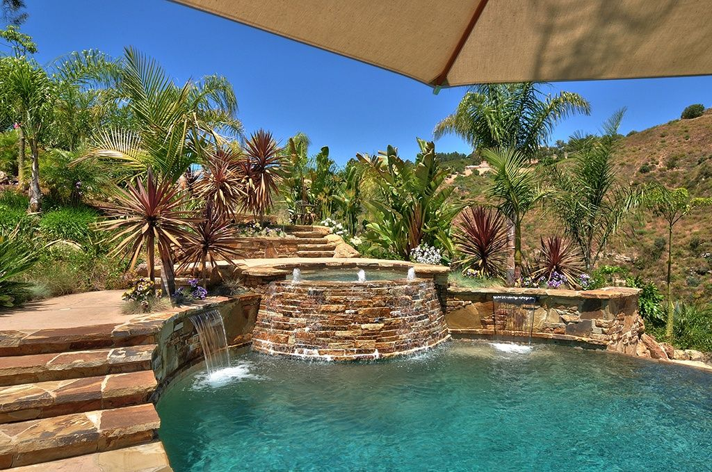 Rustic Swimming Pool with exterior stone floors, Pathway, Pool with hot tub