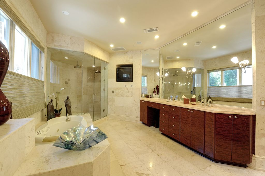 Modern Master Bathroom with full wall mirror, Complex marble counters, custom shower, Undermount sink, Shower head, Flush