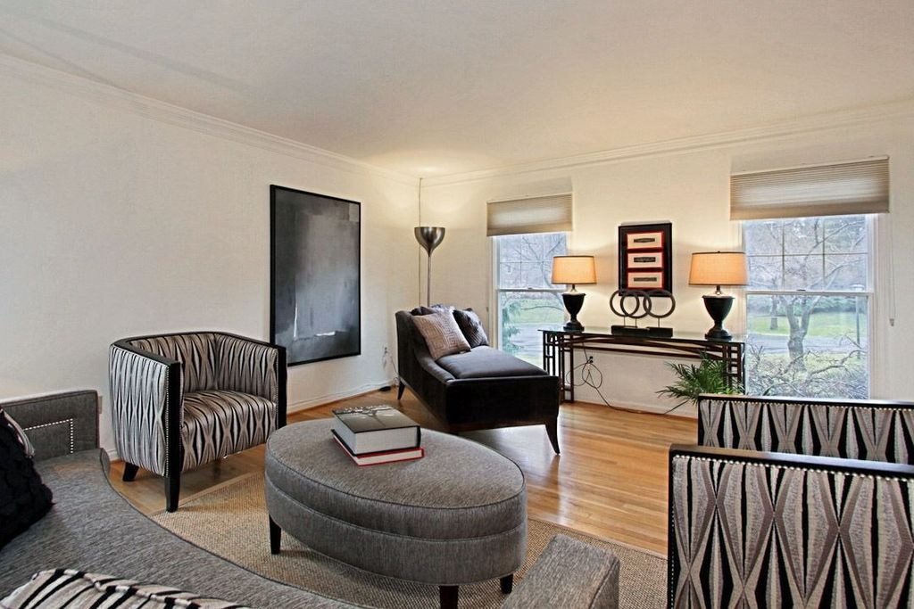 Modern Living Room with Standard height, Crown molding, Hardwood floors, double-hung window