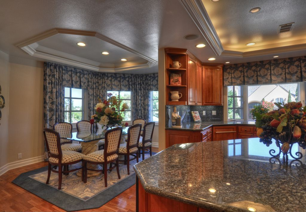 Traditional Dining Room with Casement, High ceiling, Hardwood floors, Crown molding, can lights