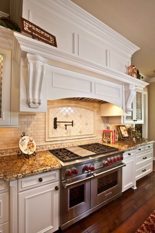 Traditional Kitchen with Crown molding, Glass panel, Complex granite counters, Quartz counters, Custom range hood, One-wall