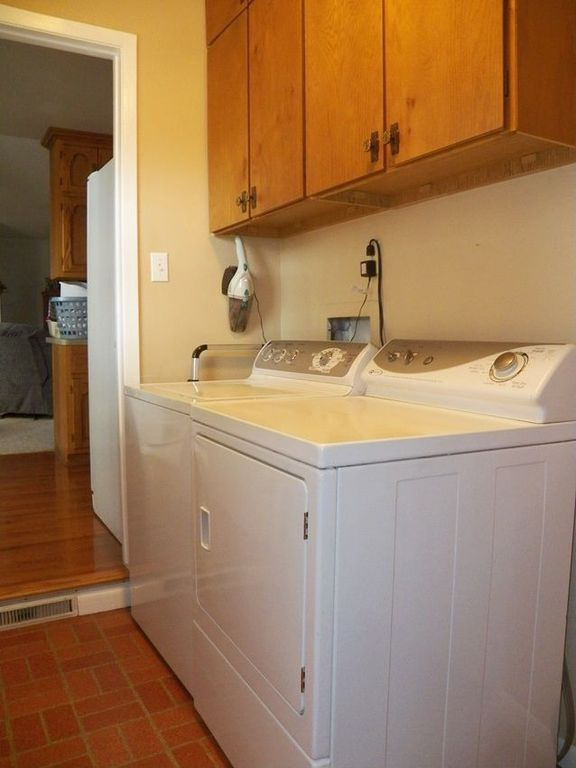 Traditional Laundry Room with Standard height, laundry sink, Built-in bookshelf, Brick floors, Drop-in sink