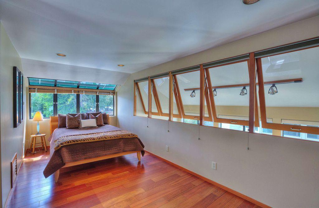 Craftsman Guest Bedroom with Hardwood floors, Standard height, can lights, Casement