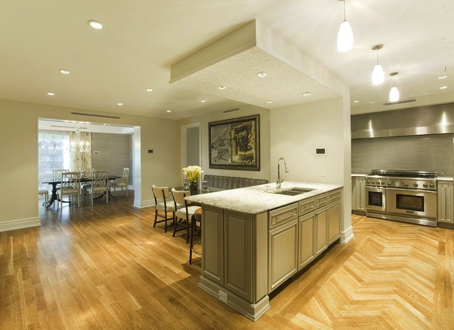 Contemporary Kitchen with Multiple Sinks, Simple granite counters, Breakfast bar, Pendant light, double oven range, Wall Hood