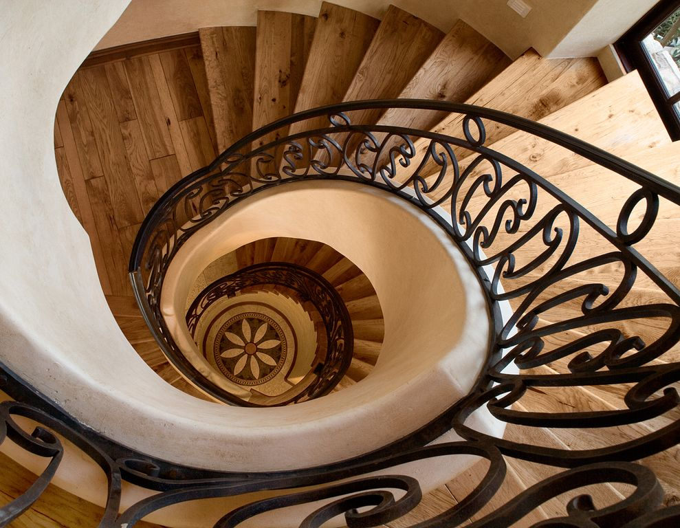 Mediterranean Staircase with Hardwood floors, Spiral staircase, High ceiling, picture window