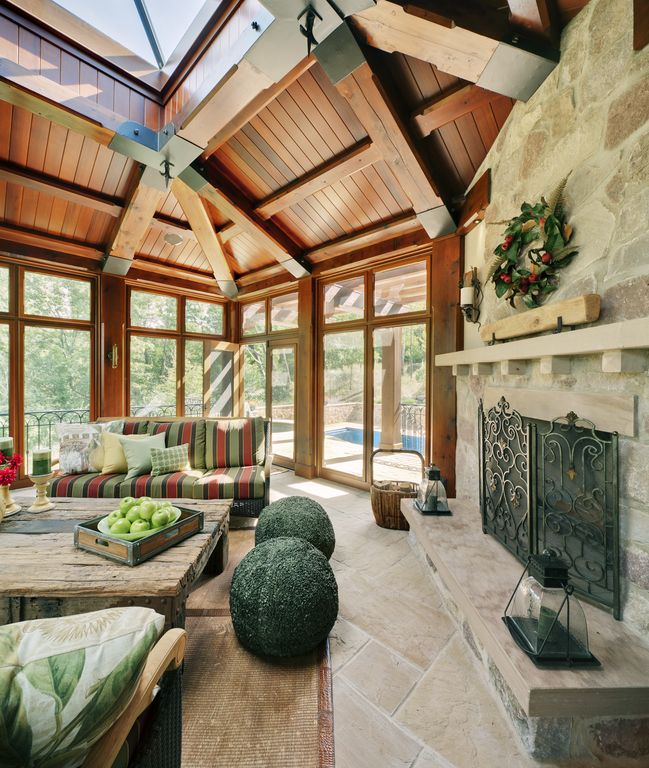 Rustic Porch with Transom window, picture window, French doors, Deck Railing, Skylight, exterior stone floors, Screened porch