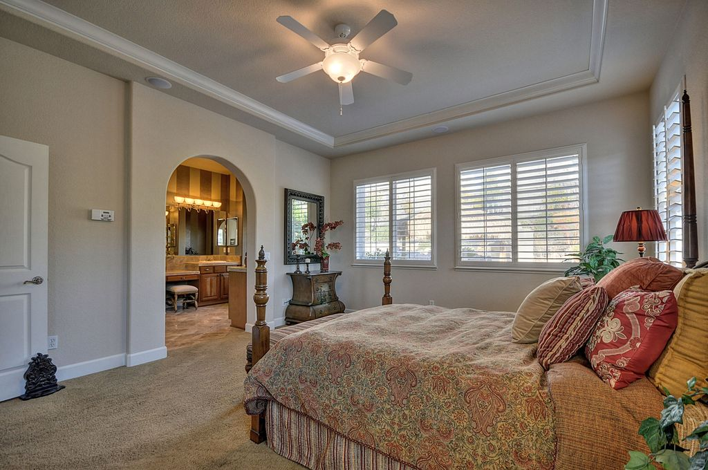 Traditional Master Bedroom with Standard height, specialty door, Crown molding, Ceiling fan, double-hung window, Carpet
