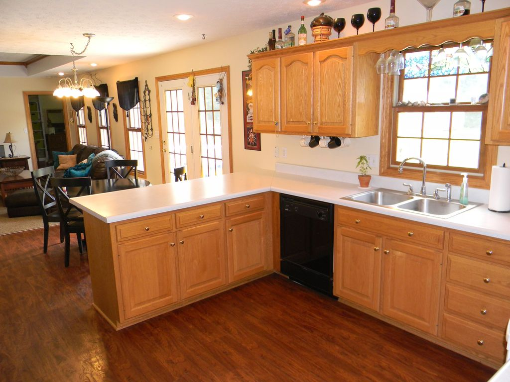 Craftsman Kitchen with Multiple Sinks, French doors, Pendant light, Standard height, Wall sconce, Raised panel, dishwasher