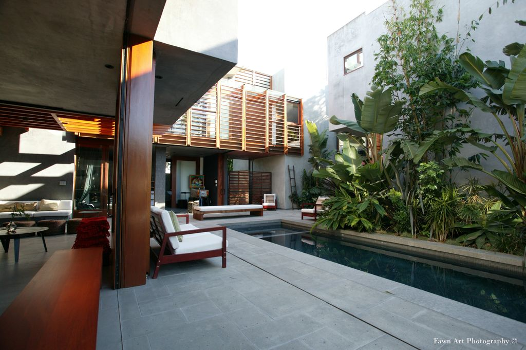 Modern Swimming Pool with specialty window, exterior tile floors, exterior concrete tile floors, Lap pool