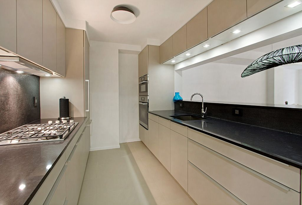 Modern Kitchen with electric cooktop, Ceramic Tile, Galley, Flush, Built In Panel Ready Refrigerator, stone tile floors