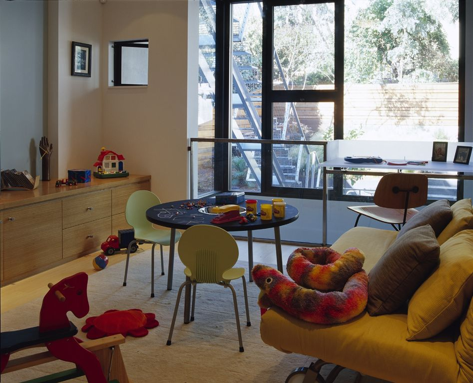Contemporary Playroom with picture window, Casement, Standard height, specialty window, Built-in bookshelf, Carpet