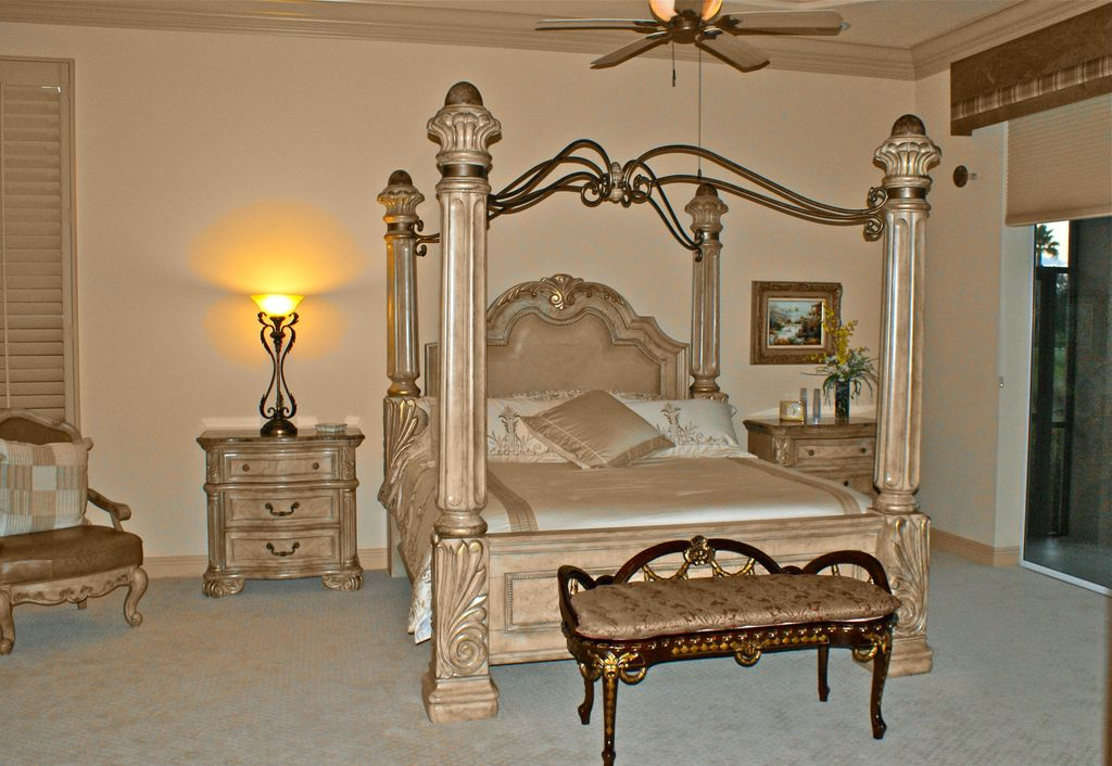 Mediterranean Master Bedroom with Standard height, Ceiling fan, Crown molding, Carpet